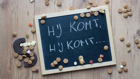 santaclaus: Sanat Claus is coming song in Dutch written on a chalkboard for the Dutch Santa-Claus