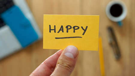 Happy written on a card at the office Stock Photo