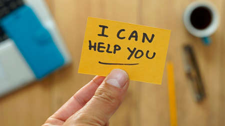 I can help you written on a card at the office