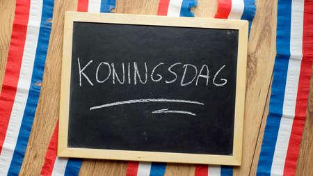 Kingsday written in Dutch on a chalkboard