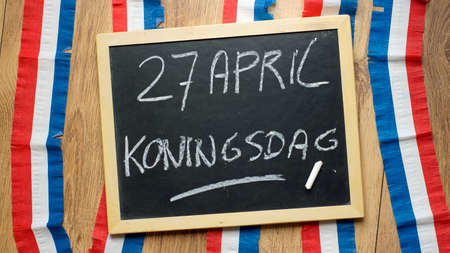 Kingsday on 27th of April written in Dutch on a chalkboard