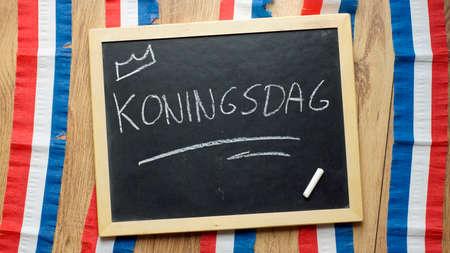 feast: Kingsday written in Dutch on a chalkboard    Stock Photo