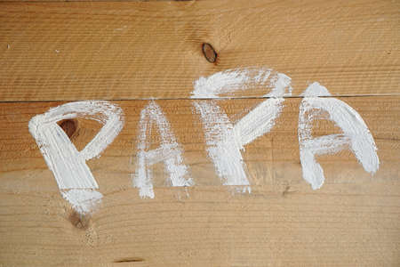 Dad written in Dutch for fathers day with paint on wood
