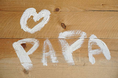 Love cdad written in Dutch for fathers day written with paint on wood Stock Photo