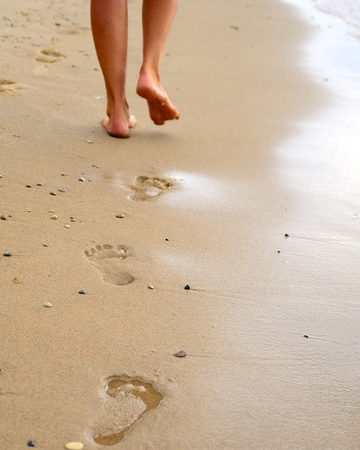 footmark: Footprints in the beach sand Stock Photo