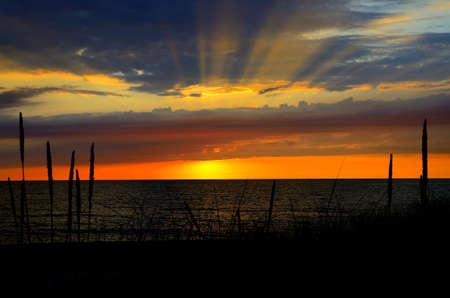 Golden sunset over the lake horizon