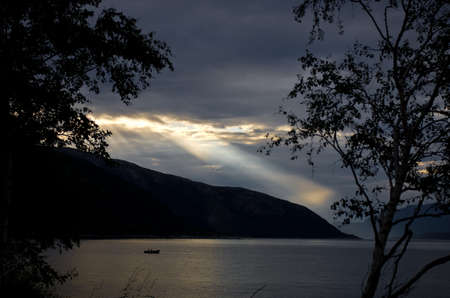 Sunrays on a fjord in norway photo