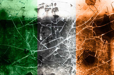 Damaged flag of Ireland photo
