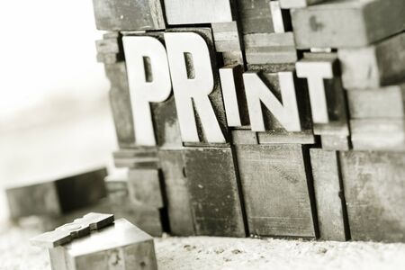 offset up: Stacked type blocks (letterpress) spelling our PRINT