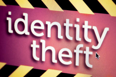 Custom made identity theft graphic with yellow and black stripes. Shallow DOF.