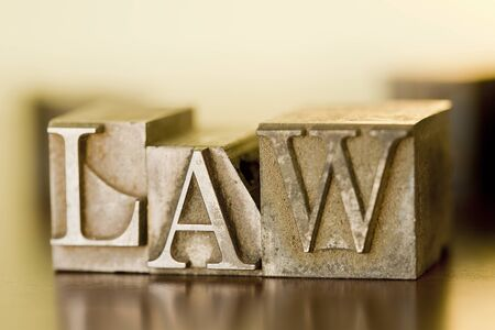 The word LAW spelled out with letterpress blocks. Stock Photo