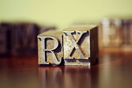 RX spelled out in letterpress blocks. Stock Photo