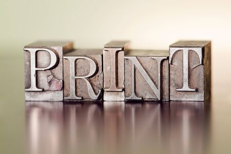 The word PRINT spelled out with letterpress blocks.