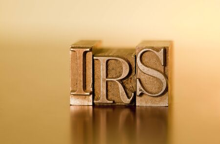 irs: The letters IRS spelled out with letterpress blocks.