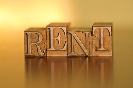 The word RENT spelled out with letterpress blocks.
