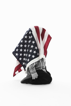 irrespeto: Young child with American flag covering him.