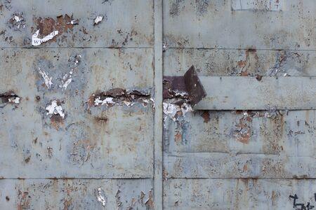 Rusty old metal door detail.