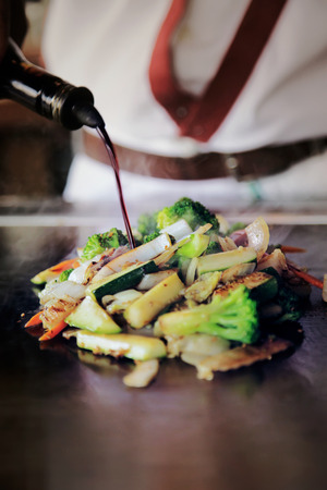 Fresh vegetables on a hot table at Hibachi restaurant. Banco de Imagens