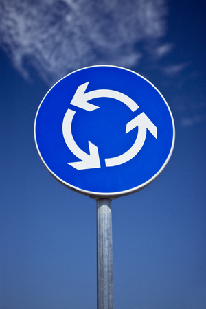 Road sign. Metaphor for going around, spinning, loading... Stock Photo