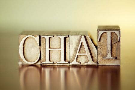 The word CHAT spelled out with letterpress blocks. Stock Photo
