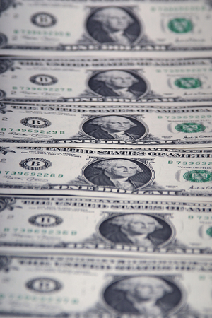 A lineup of one dollar bills.