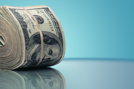 large stack of one hundred dollar bills. Image with clipping PATH.