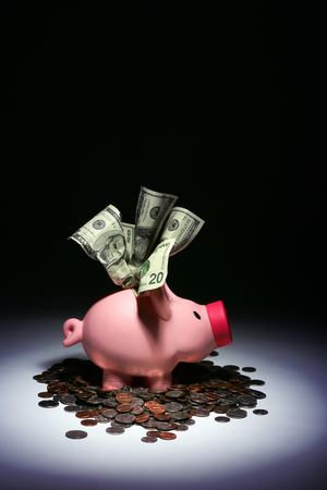 Piggy bank overflowing with savings.