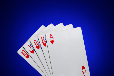Playing cards showing a Royal Flush of Hearts Stock Photo