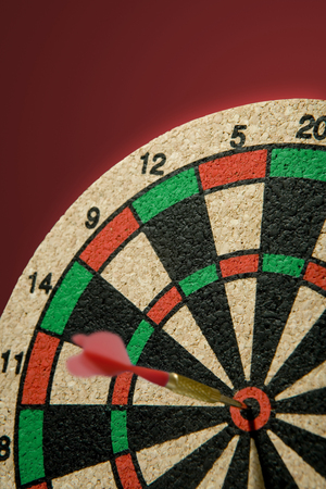 Dartboard with dart. Shallow DOF