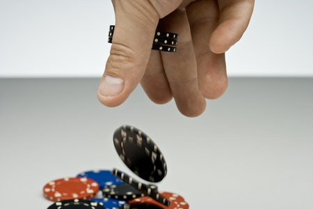 Hand throwing in black chips.