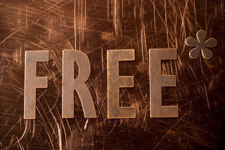 the word FREE out of copper letters on copper background