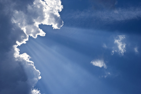 Blue sky with sunlight passing through the clouds. Stock Photo