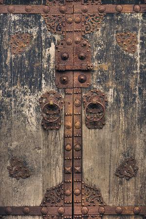 Old, Oriental-Styled wooden door. Stock Photo