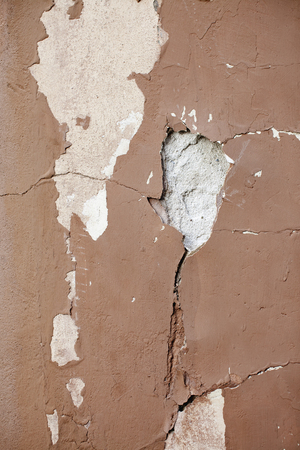 Destroyed wall with peeling paint.