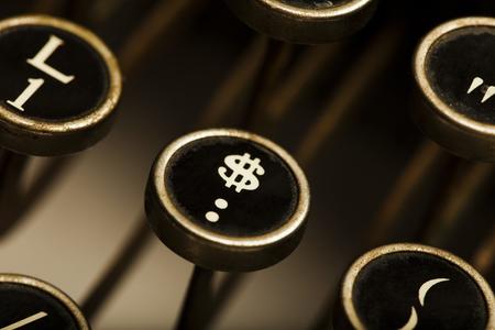 Close up of dollar sign key on an old depression era typewriter.