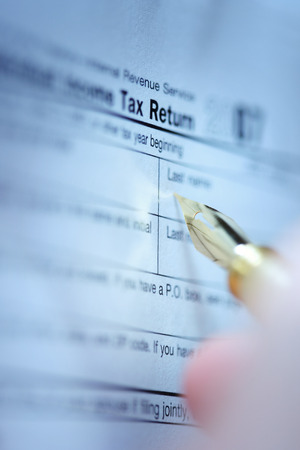 US 1040 Tax Form detail with pen Stock Photo
