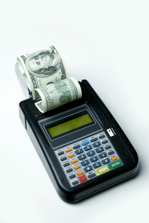 Credit Card terminal spitting out cash refund. Stock Photo