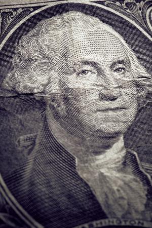Macro photo of George Washington on an used US one dollar. Imagens