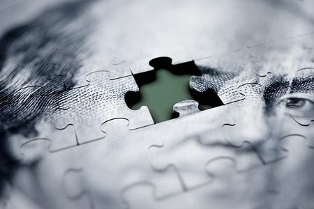 Macro shot of money puzzle.