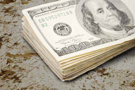 a stack of 100 dollar bills.