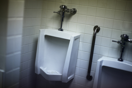 Urinals in a mens bathroom. Stock Photo