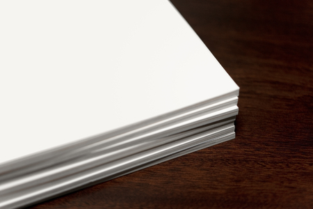 Stack of blank magazines on mahogany table. Stockfoto