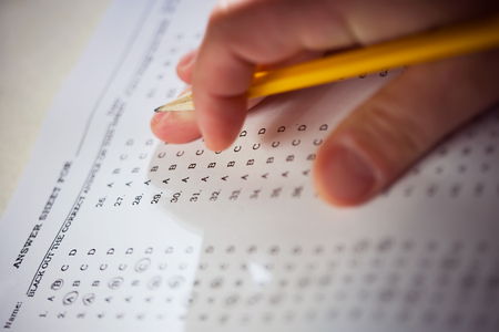 Multiple choice test and hand with pencil. Stock Photo