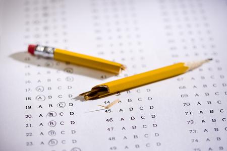 Broken pencil atop a multiple choice exam.