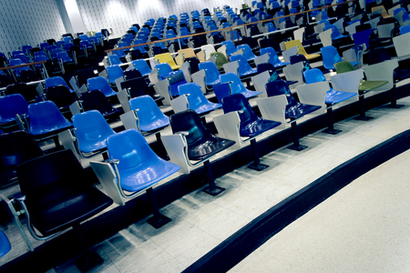 Empty seats in a lecture hall.