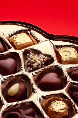 Detail of chocolate candies in a heart-shaped box. Stock fotó - 99879119