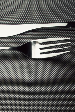A Fork and Knife placed opposite each other.