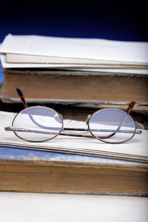 Old books and glasses.  Concept represents learning, history, education.