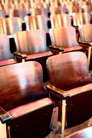 Empty wooden seats in a town hall