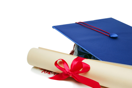 Detail of Graduation cap and rolled up diploma